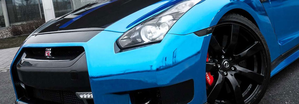 Blue chrome fiber wrap on car