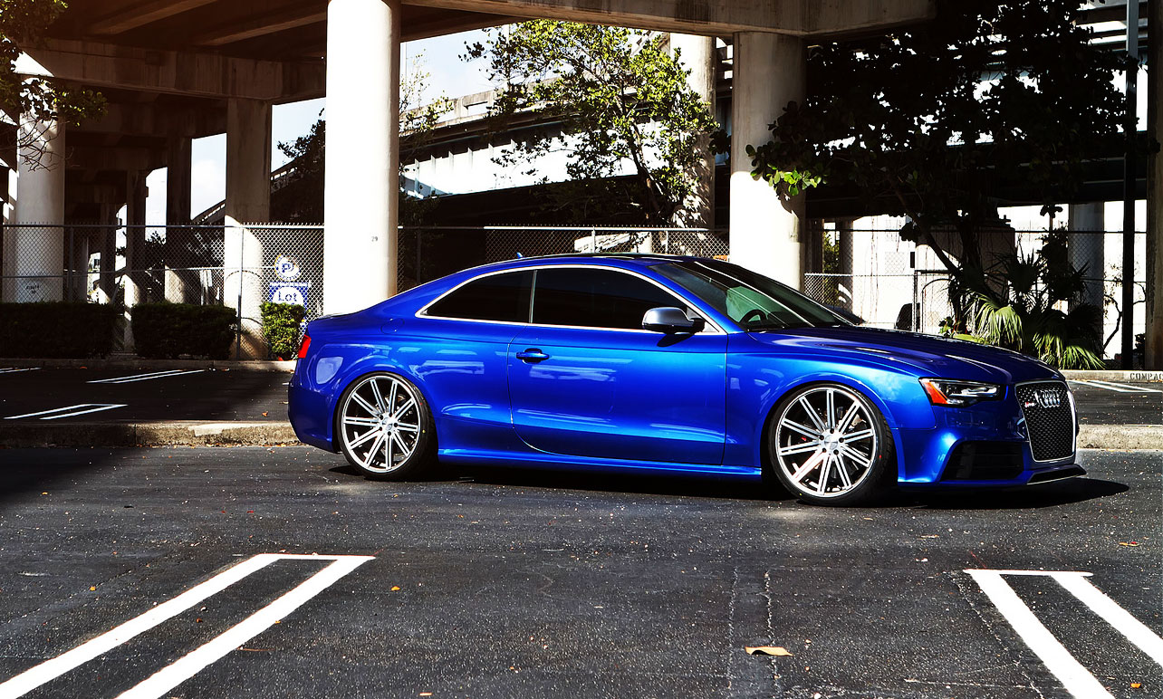 Blue Audi with freshly tinted windows
